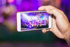 Hands use smartphones record small music concert live streaming video on internet to social media stock photos