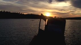 Hands used big telephone at sunset near lake. stock video footage