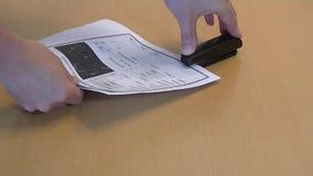 Hands using black stapler stock footage
