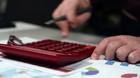 Hands Using Calculator. Accountant Hand Using Red Calculator. Business Concept. Close Up stock video footage