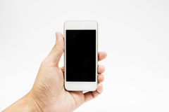 Hands Using Cell Phone. Holding smart phone in isolated background Royalty Free Stock Photography
