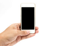 Hands Using Cell Phone. Holding smart phone in isolated background Royalty Free Stock Images