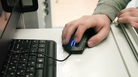 Hands Using Computer Mouse. Close up of hands using mouse for control computer stock footage