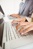 Hands using computers in office Royalty Free Stock Images