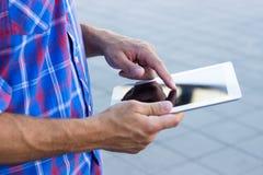 Hands using digital tablet. Hands holding digital tablet PC Stock Image