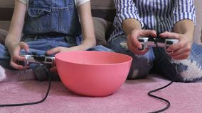 Hands using gaming consoles. In room stock video