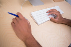 Hands using keyboard and mouse at desk Royalty Free Stock Images