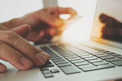 Hands using laptop and holding credit card with digital business Stock Photos