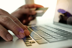 Hands using laptop and holding credit card with social media Royalty Free Stock Images