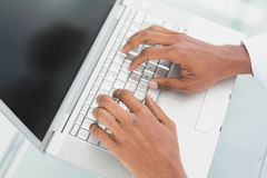 Hands using laptop at medical office Stock Image