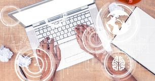 Hands using laptop with overlay Royalty Free Stock Photography