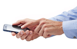 Hands Using Mobile Cell Phone. A man using a mobile touchscreen cell phone isolated on white