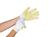Hands using rubber grip safety glove. Isolated on white with path royalty free stock photo