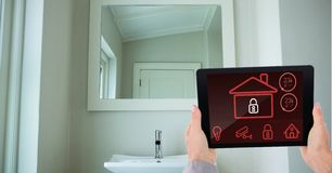 Hands using smart home application on digital tablet in washroom Stock Photos