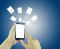 Hands using smart phone with flying envelopes. Stock Photography