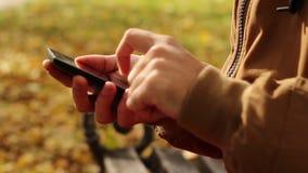 Hands Using Smartphone Outdoor stock video footage
