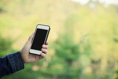 Hands using smartphone taking photo outdoor. Closeup of hands using smartphone taking photo outdoor Stock Image