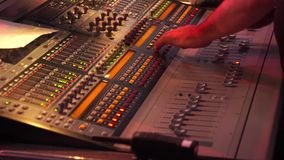 Hands using a sound digital mixer at a concert on stage stock video footage