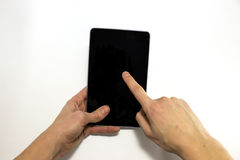 Hands are using tablet for internet surfing, isolated Stock Photo