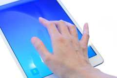 Hands using tablet pc with blue screen focus at pointer finger, Stock Image