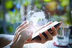 Hands using telephone device to display business data. Mobile Te. Chnology concept Royalty Free Stock Photos