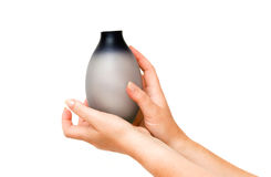 Hands with vase Stock Photography
