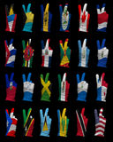 National flags of North America ,victory sign. Hands with victory sign in gloves decorated with North America flags royalty free stock images