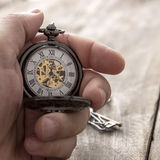 Hands with vintage pocket watch Stock Photos