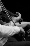 Hands of a violinist in the orchestra closeup Stock Photos