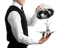 Hands of waiter with cloche. Close up hands of waiter with metal cloche and chef under it Royalty Free Stock Photo