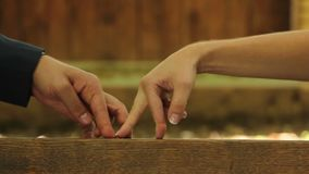Hands walking on the bench, man and woman in love. Stock footage stock footage
