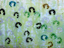 Hands on wall. Imprints of the human palm on a wall stock image