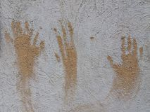 3 hands on the wall. When we need to leave some trails Stock Image