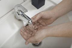 Hands wash. Unknown hands washing in a bathroom Stock Images