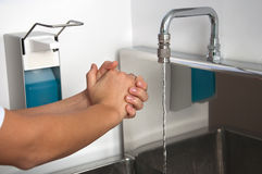 Hands wash hospital sanitizer dispenser Stock Photography