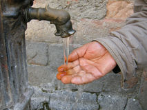 Hands washing Stock Images