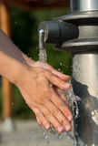 Hands Washing with Clear and Fresh Water Stock Photos