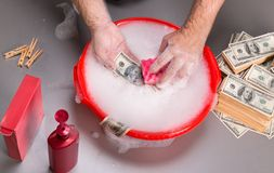 Hands are washing dollars in foam Stock Images