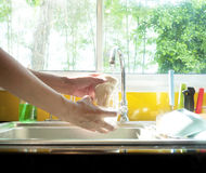 Hands washing glass Stock Photography