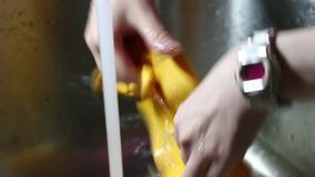 Hands washing rag in a sink stock footage