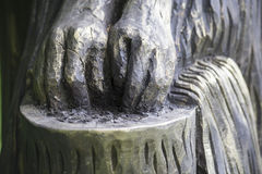 Hands washing, sculpture in wood Royalty Free Stock Photos