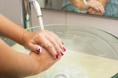 Hands washing with soap under running water Royalty Free Stock Image