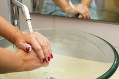 Hands washing with soap under running water Royalty Free Stock Photography
