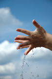 Hands in water 2. Hands splashing water against blue sky Stock Image
