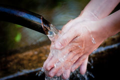 Hands and water Stock Image
