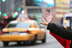 Hands waving for a cab taxi in new york Stock Images