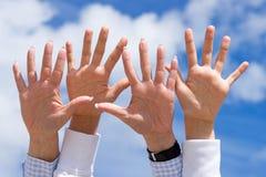 Hands waving in sky Stock Photos