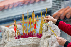 Hands Waving Smoking Incense Sticks Royalty Free Stock Photography
