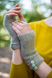 Hands Wearing Crocheted Fingerless Woolen Gloves royalty free stock photo
