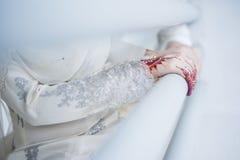 Hands wearing Henna Stock Photo